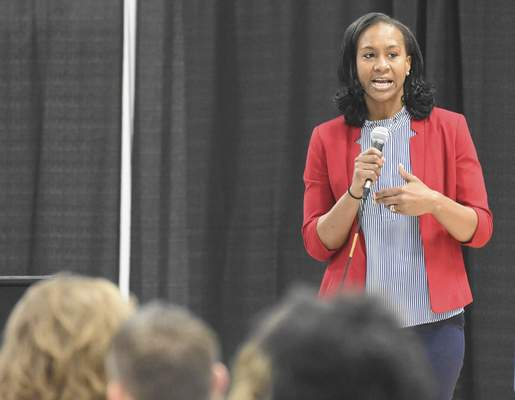 Michelle Davies | The Journal Gazette Former Tennessee star and Olympian Tamika Catchings  speaks at the Beyond the Game Leadership Luncheon on Tuesday.