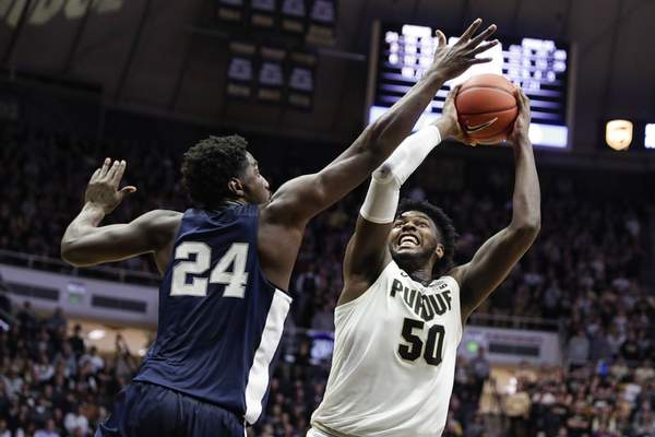 Purdue forward Trevion Williams had 17 points and 10 rebounds in the Boilermakers' 88-76 loss to No. 13 Penn State on Tuesday at Mackey Arena. (AP Photo/Michael Conroy)