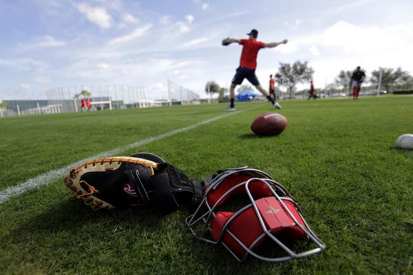 Associated Press Boston Red Sox pitchers throw after reporting for spring training in Fort Myers, Fla., on Tuesday.