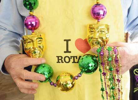 FILE A reveler hands out Mardi Gras beads at the Rotary Big Easy Feast held in the Lincoln Financial Event Center at Parkview Field.