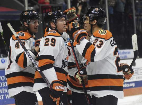 Katie Fyfe | The Journal Gazette  Komets celebrate after scoring a goal during the first period against Kalamazoo Wings at Memorial Coliseum on Wednesday.
