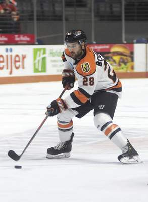 Katie Fyfe | The Journal Gazette  Komets forward Matthew Boudens prepares to make a pass during the first period against Kalamazoo Wings at Memorial Coliseum on Wednesday.