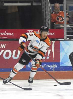 Katie Fyfe | The Journal Gazette  Komets defenseman Max Gottlieb looks to make a pass during the first period against Kalamazoo Wings at Memorial Coliseum on Wednesday.
