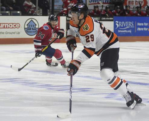 Katie Fyfe | The Journal Gazette  Komets forward Mason Bergh carries the puck with Kalamazoo forward Tanner Sorenson close behind during the first period at Memorial Coliseum on Wednesday.