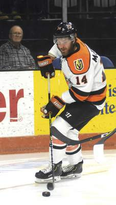 Katie Fyfe | The Journal Gazette  Komets forward Brett McKenzie carries the puck to the net during the first period against Kalamazoo Wings at Memorial Coliseum on Wednesday.