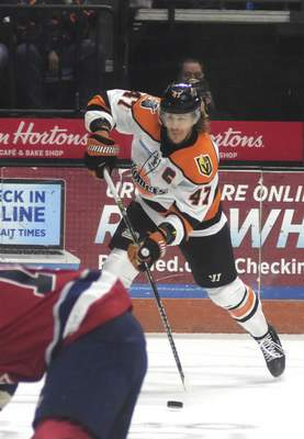 Katie Fyfe | The Journal Gazette  Komets forward A.J. Jenks looks to make a pass during the first period against Kalamazoo Wings at Memorial Coliseum on Wednesday.