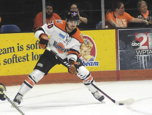 Katie Fyfe | The Journal Gazette  Komets forward Stephen Baylis makes a pass during the first period against Kalamazoo Wings at Memorial Coliseum on Wednesday.
