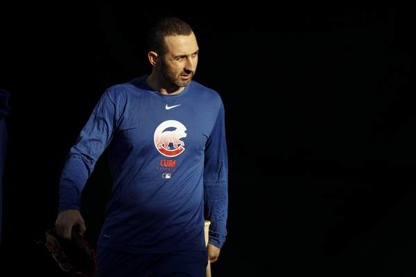 Chicago Cubs second baseman Daniel Descalso looks on during a spring training baseball workout Wednesday, Feb. 12, 2020, in Mesa, Ariz. (AP Photo/Gregory Bull)