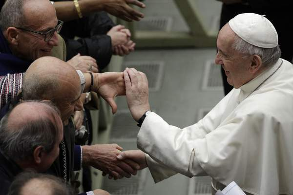 Pope Francis is greeted by faithful during the weekly general audience at the Vatican, Wednesday, Feb. 12, 2020. (AP Photo/Gregorio Borgia)