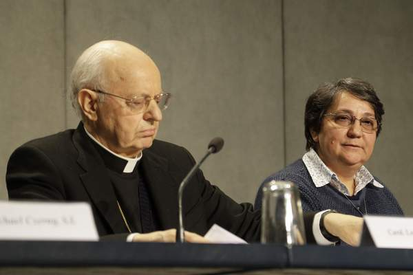 Cardinal Lorenzo Baldisseri and Sister Augusta de Oliveira attend a press conference presenting the post-synodal apostolic exhortation
