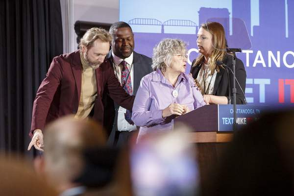 Associated Press Bernie Sanders supporter Anna Grabowski is escorted off stage after yelling into the microphone during a rally for Democratic rival Mike Bloomberg on Wednesday in Chattanooga, Tenn.