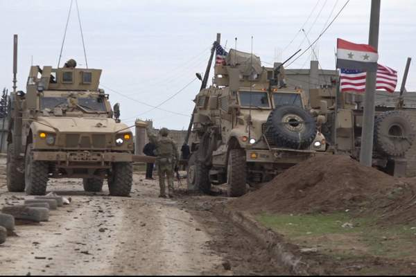 Associated Press In this image taken from video, an American military convoy is seen Wednesday in the village of Khirbet Ammu,Syria.