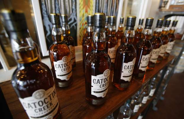 Associated Press Catoctin Creek Distillery whiskey is on display in a tasting room in Purcellville, Va. A new spirits industry report says the recent trade war hurt the overseas market for American-made whiskey last year.