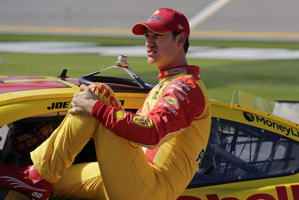 Joey Logano climbs out of his car after his run during NASCAR auto race qualifying at Daytona International Speedway, Sunday, Feb. 9, 2020, in Daytona Beach, Fla. (AP Photo/Terry Renna)