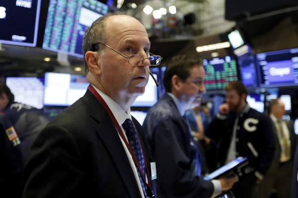 FILE - In this Feb. 6, 2020, file photo trader Gordon Charlop works on the floor of the New York Stock Exchange. (AP Photo/Richard Drew, File)