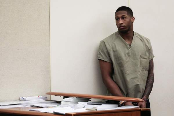 Former Ohio State Buckeyes football player Amir Riep listens during his arraignment on Thursday, Feb. 13, 2020, at the Franklin County Municipal Courthouse in Columbus, Ohio. Riep, who was dismissed from the team on Feb. 12, 2020 ,along with teammate and co-defendant Jahsen Wint, are charged with the rape and kidnapping of a 19-year-old woman on Feb. 4, 2020 at an apartment the two men share. (Joshua A. Bickel/The Columbus Dispatch via AP)