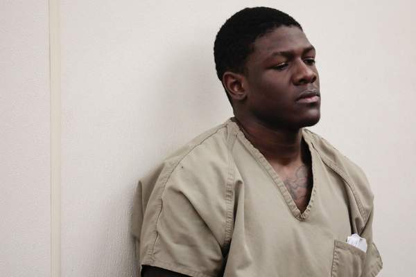Former Ohio State football player Jahsen Wint listens during his arraignment on Thursday, Feb. 13, 2020, at the Franklin County Municipal Courthouse in Columbus, Ohio. Wint, who was dismissed from the team on Feb. 12, 2020, along with teammate and co-defendant Amir Riep, are charged with the rape and kidnapping of a 19-year-old woman on Feb. 4, 2020 at an apartment the two men share. (Joshua A. Bickel/The Columbus Dispatch via AP)