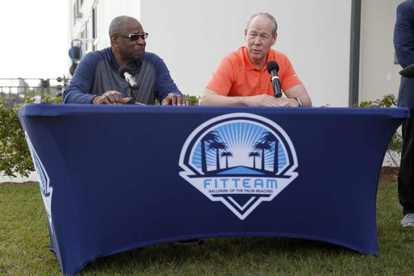 Houston Astros manager Dusty Baker, left, and owner Jim Crane speak during a news conference before the start of the first official spring training baseball practice for the team Thursday, Feb. 13, 2020, in West Palm Beach, Fla. (AP Photo/Jeff Roberson) ;