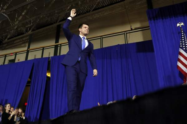 Democratic presidential candidate former South Bend, Ind., Mayor Pete Buttigieg arrives to speak to supporters at a primary night election rally at Nashua Community College, Tuesday, Feb. 11, 2020, in Nashua, N.H. (AP Photo/Andrew Harnik)