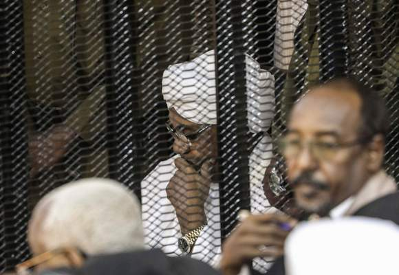 FILE - In this Aug. 24, 2019 file photo, Sudan's autocratic former President Omar al-Bashir sits in a cage during his trial on corruption and money laundering charges, in Khartoum, Sudan. (AP Photo, File)