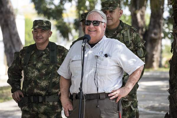 In this Jan. 29, 2020 photo, Howard Buffett smiles during a joint press conference with Colombia's President Ivan Duque at the military base in Tibu, Colombia. (AP Photo/Ivan Valencia)