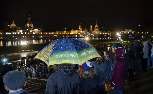 Associated Press Across the Elbe River from Dresden's historical old town, people form a human chain Thursday to mark the 75th anniversary of the German city's destructionby Allied bombs during World War II.