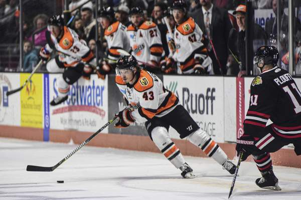 Mike Moore | The Journal Gazette Komets defenseman Gabriel Verpaelst controls the puck in the first period against Indy at Memorial Coliseum on Friday.