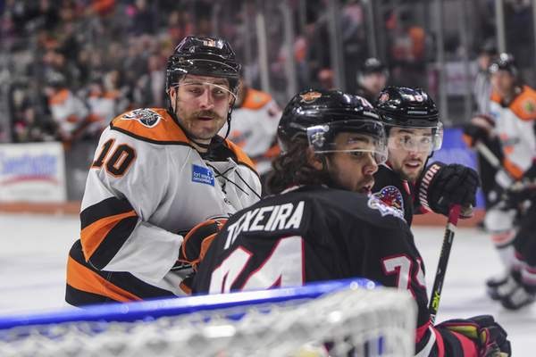 Mike Moore | The Journal Gazette Komets forward Brady Shaw watches for the puck near the net in the first period against Indy at Memorial Coliseum on Friday.