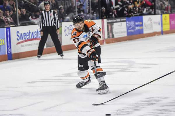 Mike Moore | The Journal Gazette Komets forward Shawn Szydlowski takes a shot at the net in the first period against Indy at Memorial Coliseum on Friday.