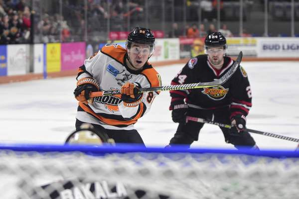 Mike Moore | The Journal Gazette Komets forward Alan Lyszczarczyk takes a shot at the net in the first period against Indy at Memorial Coliseum on Friday.