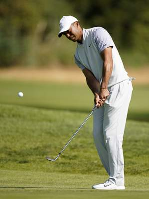 Tiger Woods chips onto the fourth green during the second round of the Genesis Invitational golf tournament at Riviera Country Club, Friday, Feb. 14, 2020, in the Pacific Palisades area of Los Angeles. (AP Photo/Ryan Kang)