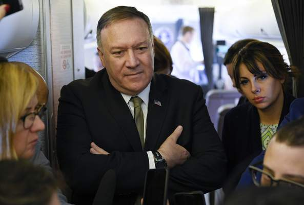 """Secretary of State Mike Pompeo takes questions from reporters during a flight from Andrews Air Force Base, Md., to Germany, Thursday, February 13, 2020. Pompeo on Thursday said he is """"outraged"""" by the U.N.'s publication of a list of companies accused of violating Palestinian human rights by operating in Israel's West Bank settlements. (Andrew Caballero-Reynolds/Pool via AP)"""