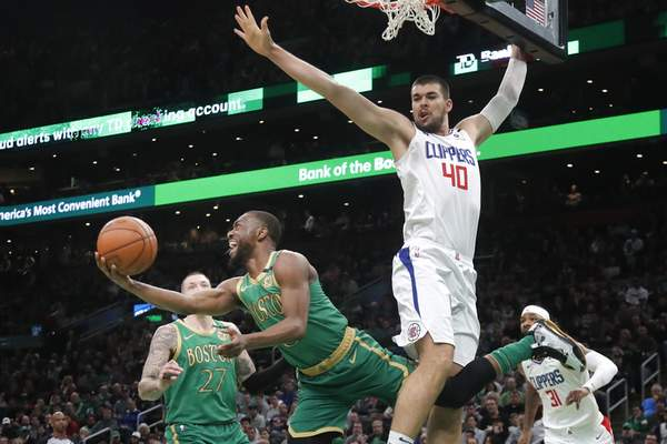 Boston Celtics guard Kemba Walker (8) shoots against the defense of Los Angeles Clippers center Ivica Zubac (40) in the first half of an NBA basketball game, Thursday, Feb. 13, 2020, in Boston. (AP Photo/Elise Amendola)
