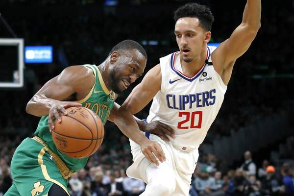 Boston Celtics guard Kemba Walker drives against Los Angeles Clippers guard Landry Shamet (20) in the first half of an NBA basketball game, Thursday, Feb. 13, 2020, in Boston. (AP Photo/Elise Amendola)