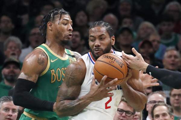 Los Angeles Clippers forward Kawhi Leonard (2) makes a move against Boston Celtics guard Marcus Smart, left, in the first half of an NBA basketball game, Thursday, Feb. 13, 2020, in Boston. (AP Photo/Elise Amendola)
