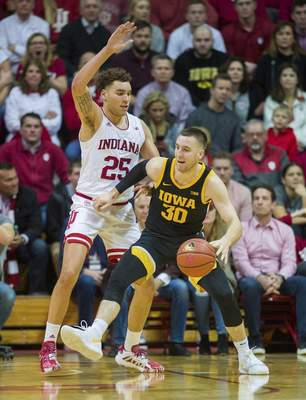 Indiana forward Race Thompson (25) had 10 points, four rebounds, four steals and two blocks during the Hoosiers' 89-77 win over No. 21 Iowa on Thursday. (AP Photo/Doug McSchooler)