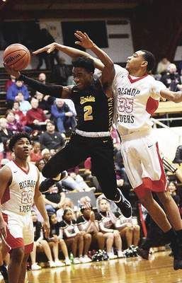 Katie Fyfe | The Journal Gazette Snider senior Jayshawn Underwood takes a shot while Bishop Luers senior John Peterson defends during the second quarter Friday at Luers.