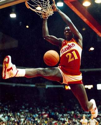 Dominique Wilkins finishes on a two-handed dunk during the 1988 NBA All-Star dunk contest. He finished second.