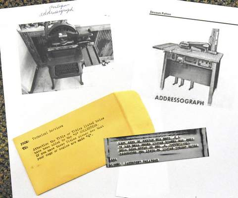 Reference photos and a printing plate are shown for how books were once added to the library system.