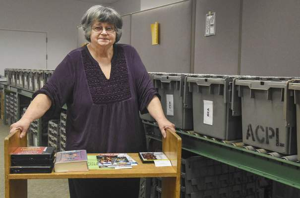 Michelle Davies | The Journal Gazette Library technician Devaun Patten at the Allen County Public Library's Technical Services building. Patten is retiring after 62 years of working for the library.
