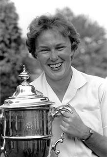 Obit Mickey Wright Golf FILE - In this July 1, 1961 file photo, Mickey Wright poses after winning her third Women's National Open golf championship, at the Baltusrol Golf Club at Springfield, N.J. Hall of Fame golfer Wright, who won 82 LPGA tournaments including 13 majors, died Monday, Feb. 17, 2020, of a heart attack, her attorney said. Wright was 85. (AP Photo/File) (STF)