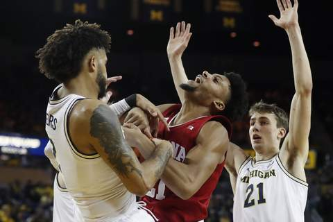 Indiana Michigan Basketball Indiana forward Jerome Hunter, center, and Michigan forward Isaiah Livers, left, fight for the rebound during the first half Indiana's 89-65 loss to the Wolverines at the Crisler Center on Sunday.Hunter led Indiana with five rebounds. (AP Photo/Carlos Osorio) (Carlos Osorio STF)