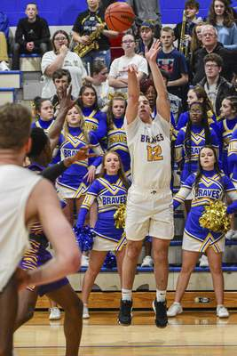 Mike Moore | The Journal Gazette Blackhawk Christian junior Callan Wood shoots a 3-pointer in the first quarter against Marion on Tuesday night at Blackhawk Christian.