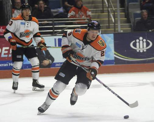 Katie Fyfe | The Journal Gazette  Komets forward Mason Bergh chases the puck during the second period against Kalamazoo at Memorial Coliseum on Wednesday.