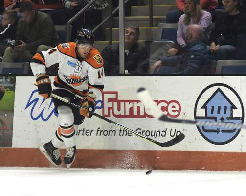 Katie Fyfe | The Journal Gazette  Komets forward Brett McKenzie chases after the puck during the second period against Kalamazoo at Memorial Coliseum on Wednesday.