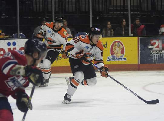 Katie Fyfe | The Journal Gazette  Komets forward Alan Lyszczarczyk carries the puck during the second period against Kalamazoo at Memorial Coliseum on Wednesday.