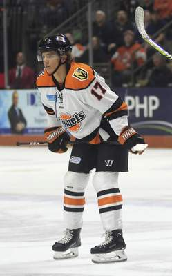 Katie Fyfe | The Journal Gazette  Komets forward Brad Morrison prepares for a faceoff during the second period against Kalamazoo at Memorial Coliseum on Wednesday.
