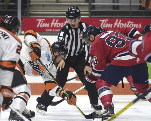 Katie Fyfe | The Journal Gazette  The referee drops the puck for a faceoff during the second period between the Komets and Kalamazoo at Memorial Coliseum on Wednesday.