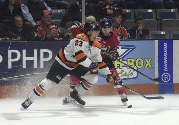 Katie Fyfe | The Journal Gazette  Komets defenseman Max Gottlieb steals the puck during the second period against Kalamazoo at Memorial Coliseum on Wednesday.