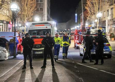 Germany Shooting Police guard the scenery in front of a restaurant in central Hanau, Germany Thursday, Feb. 20, 2020. German police say several people were shot to death in the city of Hanau on Wednesday evening. (AP Photo/Michael Probst) (Michael Probst STF)